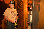02 JUNE 2011 - ALPINE, AZ: Carl Vance (CQ) a volunteer with the Apache County Sheriff Dept tells Teresa Pinter (CQ) that she and her husband have to evacuate their home in the Chapache development becauce of the Wallow Fire near Alpine. High winds and temperatures complicated firefighters' efforts to get the blaze under control. Officials have issued a mandatory evacuation order and residents of the Alpine area had to leave by 8PM Thursday. PHOTO BY JACK KURTZ