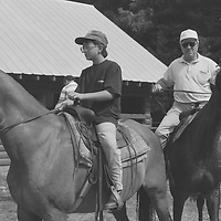 1. When was this photo taken?<br /> <br /> 1992<br /> <br /> 2. Where was this photo taken?<br /> <br /> At a horseback riding resort in upstate New York<br /> <br /> 3. Who took this photo?<br /> <br /> Nancy Kaye<br /> <br /> 4. What are we looking at here?<br /> <br /> My nephew Matthew, as an adolescent, and his grandfather Sam (my father), sharing a horseback riding experience at a family reunion in upstate New York.<br /> <br /> 5. How does this old photo make you feel?<br /> <br /> This image evokes in me a mixture of longing and bittersweet feelings. My nephew Matthew was very close with his grandfather, who passed away only seven years after this photo was taken. The loss was extremely difficult for Matthew. He is now a father of 2 boys and named his older son Sam, after his grandfather (and my father). I see in this photo my father as I&rsquo;d like to remember him--strong and enjoying time with his family.<br /> <br /> 6. Is this what you expected to see?<br /> <br /> No! I had forgotten about these images and the details of this extended family reunion. <br /> <br /> 7. Does this photo bring back any memories?<br /> <br /> Yes, this brings back memories of my father, who so enjoyed his close relationship with Matthew, his first grandchild. I see in this photo the vigorous, optimistic person that my father was. I had no way of knowing at the time that this sort of physical activity would not be possible for him in a few short years.<br /> <br /> 8. How do you think others will respond to this photo? <br /> <br /> I think that people will notice how serious they look and how my father's horse appears to be challenging him. Nevertheless this was a special moment that grandfather and grandson had together, taking pleasure from each other's company.