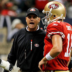 August 12, 2011; New Orleans, LA, USA; San Francisco 49ers head coach Jim Harbaugh talks with quarterback Alex Smith (11) prior to kickoff of a preseason game against the New Orleans Saints at the Louisiana Superdome. Mandatory Credit: Derick E. Hingle