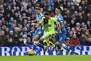 Brighton central midfielder, Beram Kayal (7) pulls the shirt of Huddersfield Town striker Nahki Wells (21) during the Sky Bet Championship match between Brighton and Hove Albion and Huddersfield Town at the American Express Community Stadium, Brighton and Hove, England on 23 January 2016. Photo by Geoff Penn.