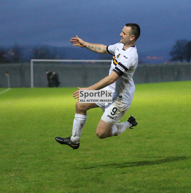 Garry Fleming runs to the home support during the Dumbarton v Queen of the South  Scottish Cup 4th Round  09 January 2016<br /> <br /> (c) Andy Scott | SportPix.org.uk