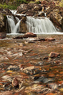 Red Rock Falls is a small but scenic waterfall on Swiftcurrent Creek just beyond Red Rock Lake.  The falls can be reached from the Swiftcurrent Trail which starts at the Many Glacier area of Glacier National Park.