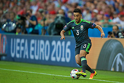 LYON, FRANCE - Wednesday, July 6, 2016: Wales' Neil Taylor in action against Portugal during the UEFA Euro 2016 Championship Semi-Final match at the Stade de Lyon. (Pic by David Rawcliffe/Propaganda)