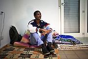 Ritratto di ragazzo su coperte. Interno ex palazzine olimpiche.