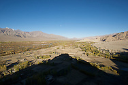 Thiksey Monastery casts a shadow over the Indus River Valley, Ladakh, India.