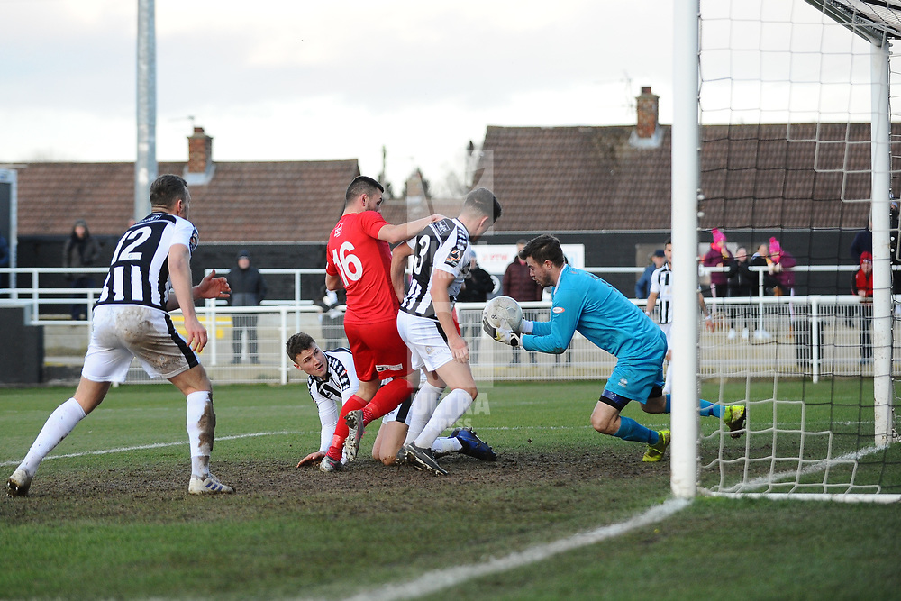 TELFORD COPYRIGHT MIKE SHERIDAN  CHANCE. Aaron Williams of Telford  in unable to squeeze the ball past Matt Gould during the Vanarama Conference North fixture between Spennymoor Town and AFC Telford United at Brewery Field, Spennymoor on Saturday, February 29, 2020.<br /> <br /> Picture credit: Mike Sheridan/Ultrapress<br /> <br /> MS201920-048