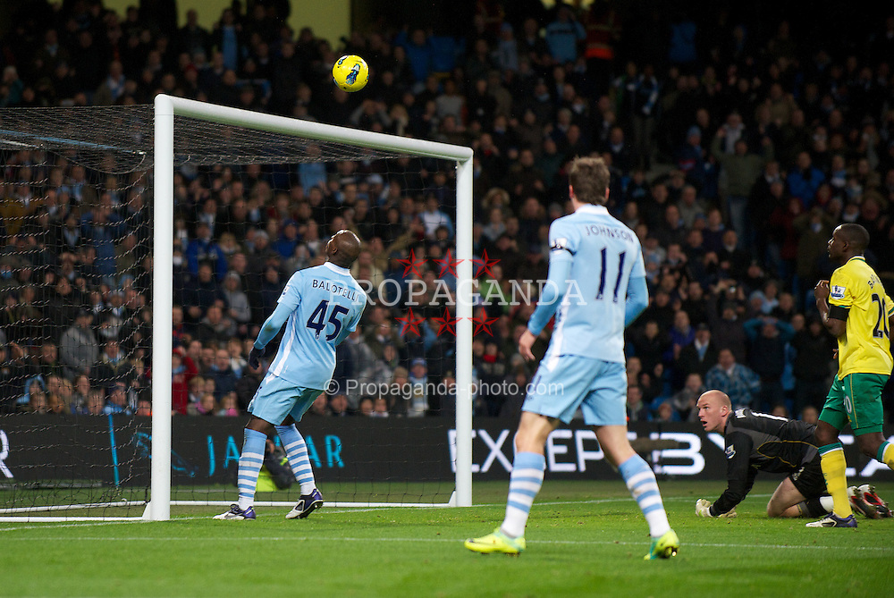 MANCHESTER, ENGLAND - Saturday, December 3, 2011: Manchester City's Mario Balotelli scores the fourth goal against Norwich City by nonchalantly knocking it in with his shoulder during the Premiership match at City of Manchester Stadium. (Pic by David Rawcliffe/Propaganda)