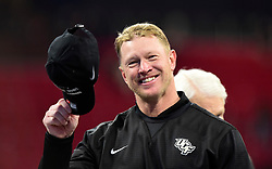 UCF Knights head coach Scott Frost tips his cap after the Chick-fil-A Peach Bowl NCAA college football game at the Mercedes-Benz Stadium in Atlanta, January 1, 2018. UCF won 34-27 to go undefeated for the season. (David Tulis via Abell Images for Chick-fil-A Peach Bowl)