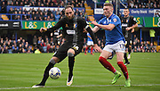 Lee Collins protects the ball from Caolan Lavery during the Sky Bet League 2 match between Portsmouth and Mansfield Town at Fratton Park, Portsmouth, England on 24 October 2015. Photo by Michael Hulf.