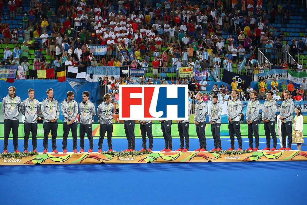 RIO DE JANEIRO, BRAZIL - AUGUST 18:  Bronze medalists Team Germany pose on the podium during the medal ceremony for the Men's Hockey Gold Medal match between Belgium and Argentina on Day 13 of the Rio 2016 Olympic Games at Olympic Hockey Centre on August 18, 2016 in Rio de Janeiro, Brazil.  (Photo by Clive Brunskill/Getty Images)