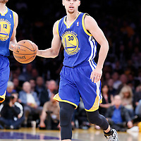 11 April 2014: Golden State Warriors guard Stephen Curry (30) brings the ball up court during the Golden State Warriors 112-95 victory over the Los Angeles Lakers at the Staples Center, Los Angeles, California, USA.