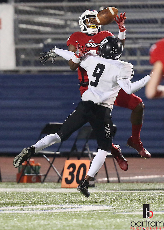 Bishop Lynch's Keion Mcgee breaks up a pass intended for Bishop Dunne's Ricky Rollerson during the TAPPS Division I state championship game on Saturday, Dec. 3, 2016 at Panther Stadium in Hewitt, Texas. Bishop Lynch High School won 21-17. (Photo by Kevin Bartram)