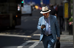 © Licensed to London News Pictures. 25/06/2018. London, UK. A man wears sunglasses and a Panama hat in The City of London as high temperatures remain in most of the UK. Photo credit: Peter Macdiarmid/LNP