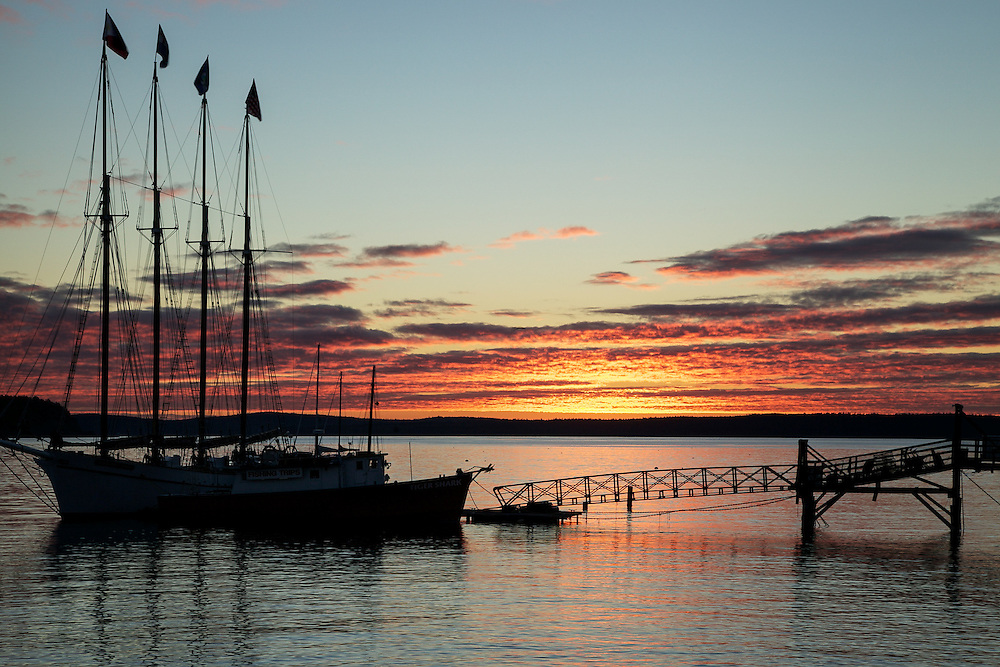 A silhouette of a boat at Sunrise in Bar Harbor, Maine