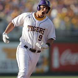 09 June 2008:  Matt Clark #9 screams in celebration as he rounds third base following a solo homerun, the third consecutive home run for LSU in the inning. The LSU Tigers advanced to the College World Series with a 21-7 victory over the UC Irvine Anteaters in game three of the NCAA Baseball Baton Rouge Super Regional Alex Box Stadium in Baton Rouge, LA..