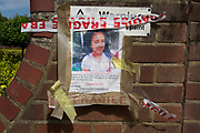 Twelve days after the devastating fire that killed an unspecified number of people is the torn poster of a young girl called Jessica Urbano, missing from Grenfell tower block which remains a crime scene, on 26th June 2017, in the London borough of Kensington & Chelsea, England.