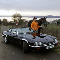 Derek Butcher, Knockhill Racing Circuit boss pictured with his horse 'Neason' and his Jaguar XJSC, near his home in Dalgety bay.<br />Picture by Graeme Hart.<br />Copyright Perthshire Picture Agency<br />Tel: 01738 623350  Mobile: 07990 594431