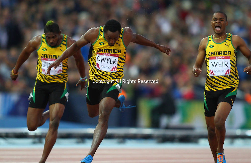 31.07.2014. Glasgow, Scotland. Glasgow Commonwealth Games. Men's 200m final from Hampden Park. Rasheed Dwyer, Warren Weird and Jason Livermore cross the finish line to get Jamaica gold silver and bronze