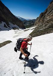 THEMENBILD - Rutschgefahr bei Schneefeldern in den Alpen. Durch Altschneefelder und mangelnder Ausruestung bei Wanderern kommt es vermehrt zu Unfaellen beim Queren von Schneefeldern. Das Bild wurde am 16. Juli 2013 waehrend einer Tour in der Granatspitzgruppe aufgenommen. im Bild Wanderer quert Schneefeld // THEME IMAGE FEATURE - Danger of Slipping on Snowfields. The image was taken on july, 16th, 2013. Picture shows Mountaineer walks on a Snwofield , AUT, EXPA Pictures © 2013, PhotoCredit: EXPA/ Michael Gruber