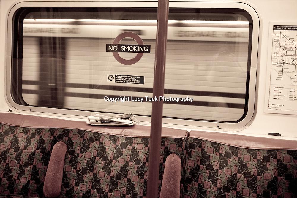 London tube interior photo, newspaper left on tube, deserted tube, empty Tube, London underground