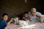 Jose Angel Galaviz Carrillo eats breakfast with his two youngest sons at his ranch home in Maycoba, Sonora, Mexico. (Jose Angel Galaviz Carrillo is featured in the book What I Eat: Around the World in 80 Diets.)