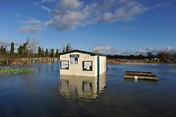 © Licensed to London News Pictures. Date 9 Jan 2014. Oxford. Allotments flooded. River Thames floods at Oxford causing the closure of the Abingdon and Botley roads.. Photo credit : MarkHemsworth/LNP