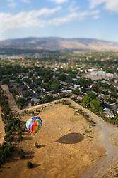"""Balloon Over Reno 3"" - This hot air balloon was photographed over Reno, Nevada during the 2011 Great Reno Balloon Race. The ""toy"" like effect was achieved using a tilt-shift lens."