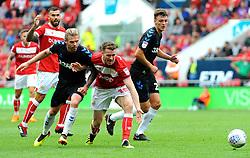 Marley Watkins of Bristol City is cahllenged by Adam Clayton of Middlesbrough - Mandatory by-line: Nizaam Jones/JMP- 18/08/2018 - FOOTBALL - Ashton Gate Stadium - Bristol, England - Bristol City v Middlesbrough - Sky Bet Championship