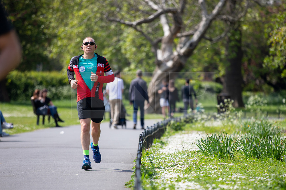 © Licensed to London News Pictures. 30/04/2019. London, UK. A man jogs in Regent's Park on a warm afternoon in central London. Photo credit : Tom Nicholson/LNP