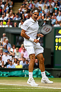LONDON, ENGLAND - JULY 6: Roger Federer of Switzerland reacts during the Gentlemens'  Singles final match against Novak Djokovic of Serbia on day thirteen of the Wimbledon Lawn Tennis Championships at the All England Lawn Tennis and Croquet Club at Wimbledon on July 6, 2014 in London, England.