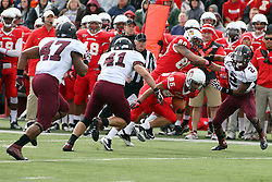 06 October 2012:  Lechein Neblett ducks for a hole as James O'Shaughnessy pushes Courtney Richmond wide during an NCAA football game between the Southern Illinois Salukis and the Illinois State Redbirds at Hancock Stadium in Normal IL