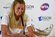 Petra Kvitova of the Czech Republic looks at her trophy during the press conference at the Final of the Aegon Classic Birmingham at Edgbaston Priory Club, Edgbaston, United Kingdom on 25 June 2017. Photo by Martin Cole.