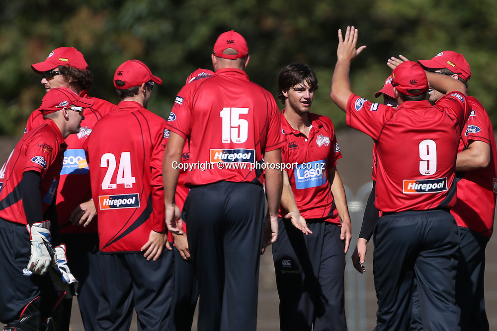 Ryan McCone of the Wizards celebrates the wicket of Jono Hickey of the <br /> Knights with team mates during the Ford Trophy cricket match between the Canterbury Wizards v Northern Knights at Hagley Oval, Christchurch. 26 March 2014 Photo: Joseph Johnson/www.photosport.co.nz