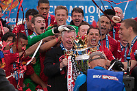 Football - Premier League 2012 / 2013 - Manchester United vs. Swansea<br /> Alex Ferguson, manager of Manchester United leads celebrations with the trophy at Old Trafford