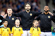 Scotland midfielder Callum McGregor (10) (Celtic) Scotland defender Charlie Mulgrew (4) (Wigan Athletic) and Scotland forward Matt Phillips (19) (West Bromwich Albion) during the UEFA European 2020 Qualifier match between Scotland and Belgium at Hampden Park, Glasgow, United Kingdom on 9 September 2019.
