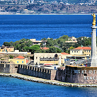 """Madonna Della Lettera in Messina, Italy <br /> The gilded statue on a 197 foot pedestal is Madonna della Lettera.  Since it was erected in 1934 on a breakwater at Forte del Santissimo Salvatore, the 23 foot monument has been a proud testament to the Virgin Mary. In 42 AD, she sent a Holy Letter to Messina citizens after they were converted to Christianity by Apostle Paul and then followed him to Palestine to visit her. The inscription at the base was the last sentence of her letter.  It means, """"We Bless You and The City."""""""
