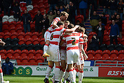 Doncaster Rovers No 24 Tommy Rowe Is Congratulated By His Team Mates during the Sky Bet League 1 match between Doncaster Rovers and Coventry City at the Keepmoat Stadium, Doncaster, England on 23 April 2016. Photo by Stephen Connor.