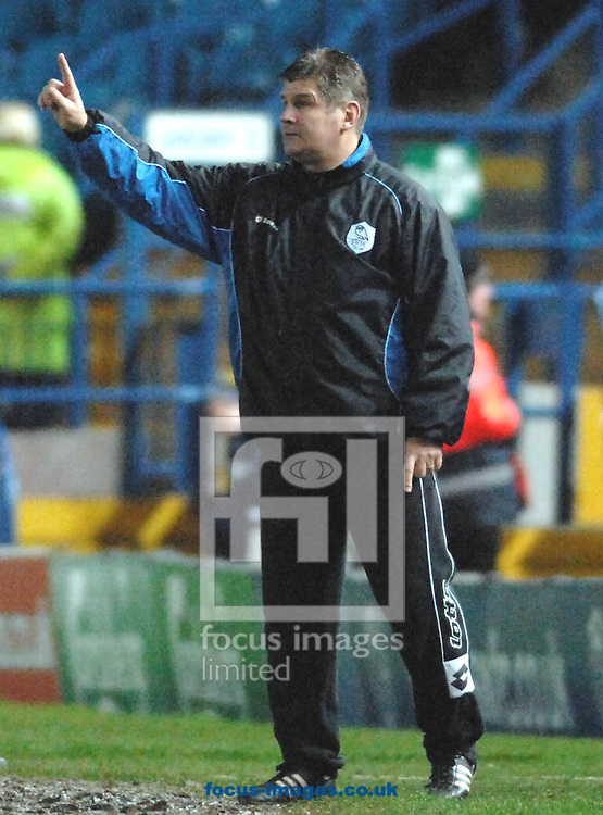 Sheffield - Tuesday, March 3rd, 2009:  Sheffield Wednesday's manager Brian Laws confirms the score of 1-0 at half time agaianst Reading FC's during the Coca Cola Championship match at Hillsboroughh, Sheffield. (Pic by John Rushworth/Focus Images)