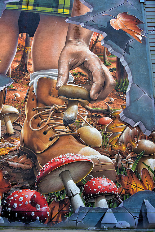Fellow Glasgow Residents Hiker Mural in Glasgow, Scotland <br /> This mural of a hiker picking a mushroom from the woodlands looks like a scene from a fairytale.  It is my favorite part of a huge street painting on Ingram Street called, &ldquo;Fellow Glasgow Residents.&rdquo;  The rest of this art by Smug One features wild animals residing in and around the city. You can see this and other spectacular outdoor art on the Glasgow City Centre Mural Trail.
