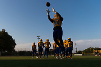 Grant Pacers Andre Lopa (54), warms aug before the game s the Capitol Christian Cougars host the Grant Pacers,  Friday Sep 8, 2017. photo by Brian Baer
