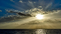 Morning sun, crepuscular rays, and clouds after breakfast from the aft deck of the MV World Odyssey. Leica T camera and 11-23 mm lens (ISO 100, 23 mm, f/14, 1/1000 sec).