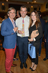 Left to right, DIMITRI HORNE, BEN PENTREATH and MELINA HORNE at a party to celebrate the publication of English Houses by Ben Pentreath held at the Art Worker's Guild, 6 Queen Square, London on 28th September 2016.