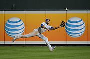 Oct 11, 2014; Baltimore, MD, USA; Kansas City Royals center fielder Lorenzo Cain (6) makes a diving catch on a ball hit by Baltimore Orioles shortstop J.J. Hardy (not pictured) in the sixth inning in game two of the 2014 ALCS playoff at Oriole Park at Camden Yards. Mandatory Credit: H. Darr Beiser-USA TODAY Sports ORG XMIT: USATSI-189998 ORIG FILE ID:  20141011_jla_aa3_090.jpg