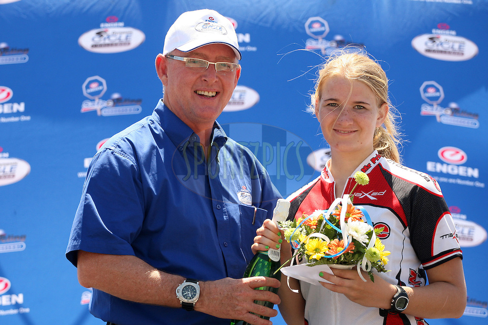 Engen Group Sponsorship Manager, Brad Bergh, with junior ladies' winner Sonya Kritzinger during the Engen Dynamic Cycle Challenge held at the Moses Mabhida Stadium in Durban, South Africa, on the 11th November 2012. Photo by Jacques Rossouw/SPORTZPICS