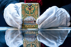 © Licensed to London News Pictures. 03/06/2016. London, UK. A staff member shows a Fabergé jewelled gold and enamelled cigarette case, made for the Romanov Tercentenary, given by Emperor Nicholas II to MM Anichkov (est. GBP 180,000-250,000), at a preview of Sotheby's Russian and contemporary central and eastern European art sale which takes place in London on 7 June. Photo credit : Stephen Chung/LNP