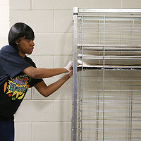 Lauren Wood   Buy at photos.djournal.com<br /> Jameela King places a pan of garlic bread on a rack to be placed in the oven Friday morning at Lawndale Elementary School.
