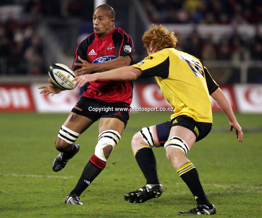 Mose Tuiali'i passes during the Round 12 Super 12 match between the Crusaders and the Hurricanes at Jade Stadium, Christchurch, New Zealand on Friday 13 May, 2005. The Crusaders won the match, 40 - 20. Photo: Hannah Johnston/PHOTOSPORT