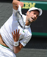 Tennis - 2019 Wimbledon Championships - Week Two, Friday (Day Eleven)<br /> <br /> Men's Singles, Semi-Final: Novak Djokovic (SRB) vs. Roberto Bautista Agut (ESP)<br /> <br /> Djokovic serves, on Centre Court.<br /> <br /> COLORSPORT/ANDREW COWIE