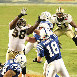 2010 February 07: Indianapolis Colts quarterback Peyton Manning (18) is pressured by New Orleans Saints defensive tackle Sedrick Ellis (98) during a 31-17 win by the New Orleans Saints over the Indianapolis Colts in Super Bowl XLIV at Sun Life Stadium in Miami Gardens, Florida.
