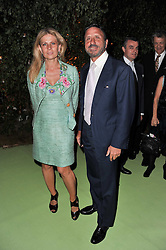 The HON.SIR ROCCO & LADY FORTE at a dinner hosted by Cartier in celebration of the Chelsea Flower Show held at Battersea Power Station, 188 Kirtling Street, London SW8 on 23rd May 2011.
